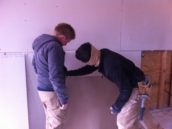 Installing sheetrock boards