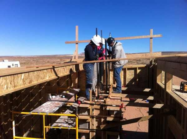 top layer if rammed earth, it will attach with the roof